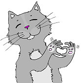 A gray cat making a heartshape with his paws