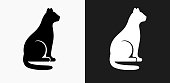 Cat Sitting Icon on Black and White Vector Backgrounds. This vector illustration includes two variations of the icon one in black on a light background on the left and another version in white on a dark background positioned on the right. The vector icon is simple yet elegant and can be used in a variety of ways including website or mobile application icon. This royalty free image is 100% vector based and all design elements can be scaled to any size.