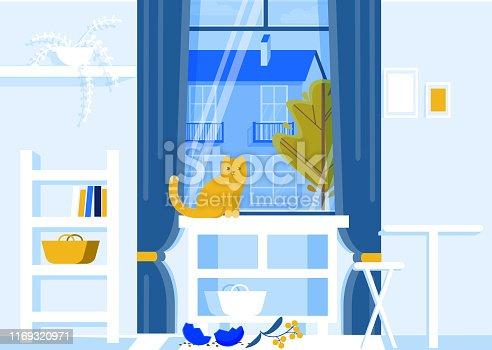 istock Cat Sitting on Table with Broken Vase on Floor. 1169320971
