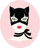 Beautiful cat-like woman wearing a cat mask. Illustrator 10 compatible EPS file. No gradients or transparency used. Global swatches for easy editing.