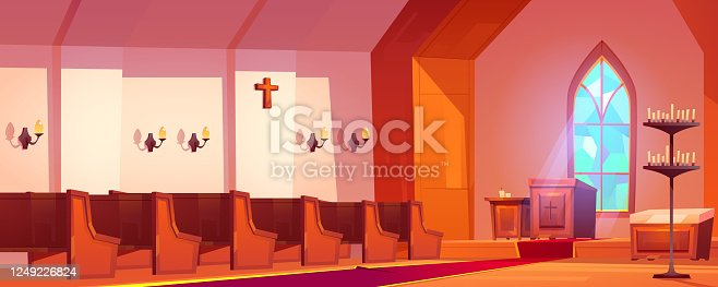 istock Catholic church interior with altar and benches 1249226824