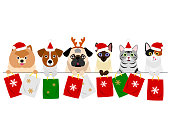 cats and dogs with Christmas shopping bags in a row