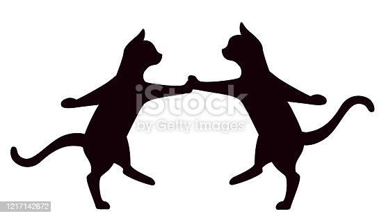istock Cats dancing rock and roll isolated on white background 1217142672
