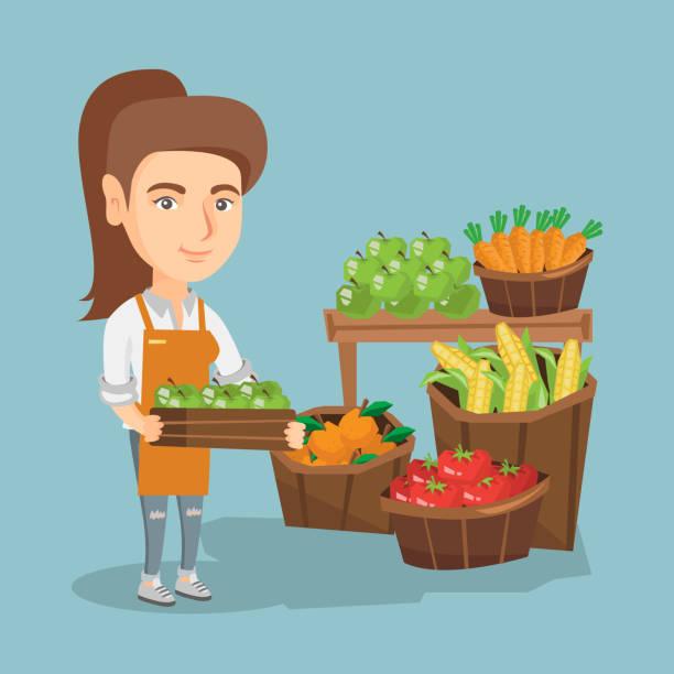 kaukasische gemüsehändler holding box mit äpfeln - rechtsassistent stock-grafiken, -clipart, -cartoons und -symbole