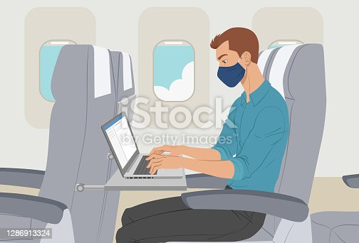 Caucasian man working on laptop while traveling on business during the sars-cov-2 pandemic