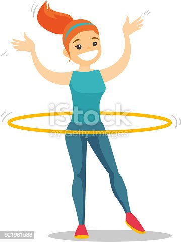 Caucasian woman doing exercises with hula hoop
