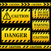 Caution and Tape Barricade Street Sign