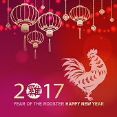 Chinese lantern and rooster paper cut art of Year of the Rooster.
