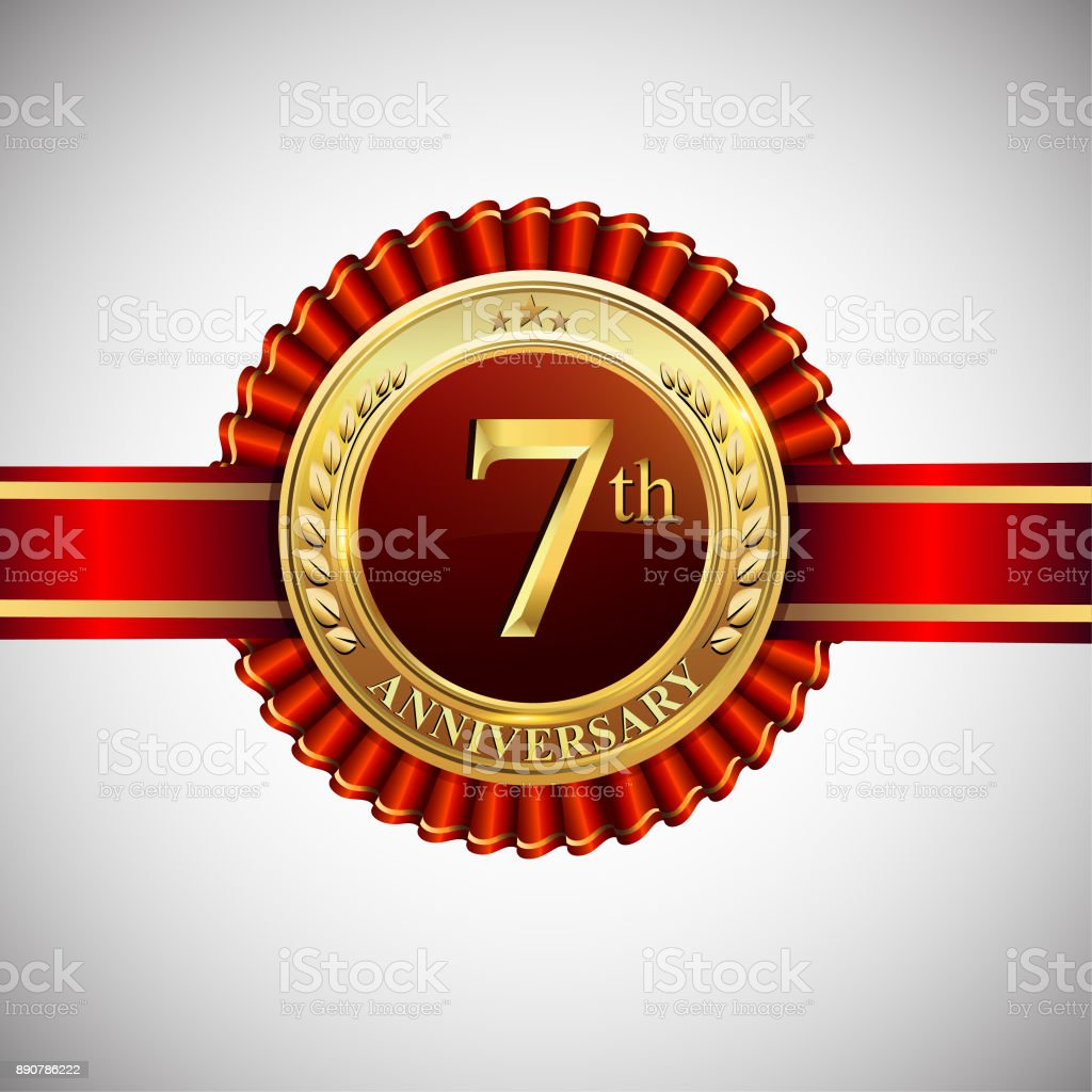 Celebrating 7th anniversary symbol, with golden badge and red ribbon isolated on white background. vector art illustration