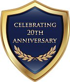 Celebrating 20th anniversary gold and blue shield.
