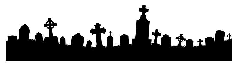 Silhouetted gravestones in a cemetery.