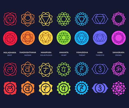 Chakra symbols set on dark background