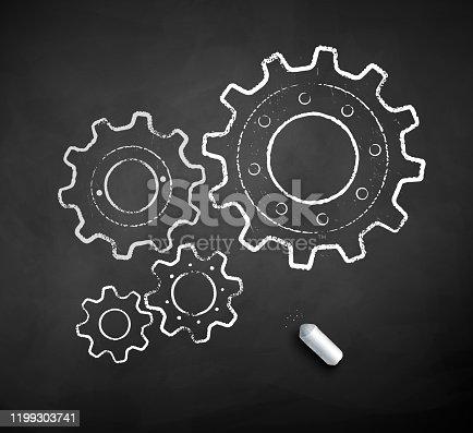 istock Chalk drawn illustration of gears 1199303741