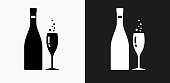 istock Champagne Bottle and Glass Icon on Black and White Vector Backgrounds 692905450