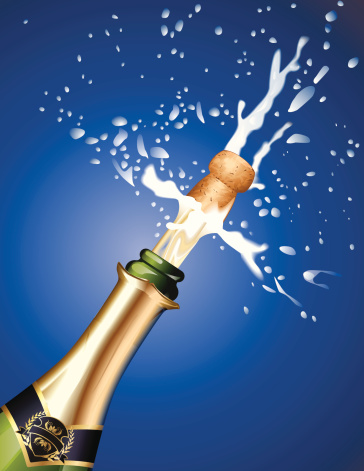 Champagne cork being popped against blue background