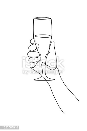 istock Champagne glass in hand 1222562918