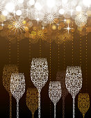 Stylized lacy champagne glasses with abstract fireworks background. Room for your own text. Great for New Years, Christmas, Anniversaries, or any Celebration. Highly detailed with grapes, vines, and bubbles. EPS 10, transparencies, gaussian blur and radial blur used. Masked file for editing if needed.