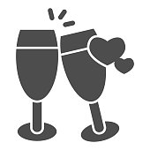 istock Champagne glasses with heart solid icon, valentine day concept, two glasses of drink sign on white background, toast to love icon in glyph style for mobile concept. Vector graphics. 1287528097