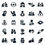 An icon set of charitable giving themes. The icons include donations of money, a helping hand, food donations, awareness ribbon, donation jar, online donating, giving gifts, a hug and an arm around shoulder to name a few.