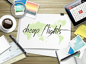 cheap flights written on paper