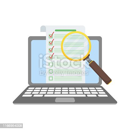 paper check list on laptop under magnifying glass