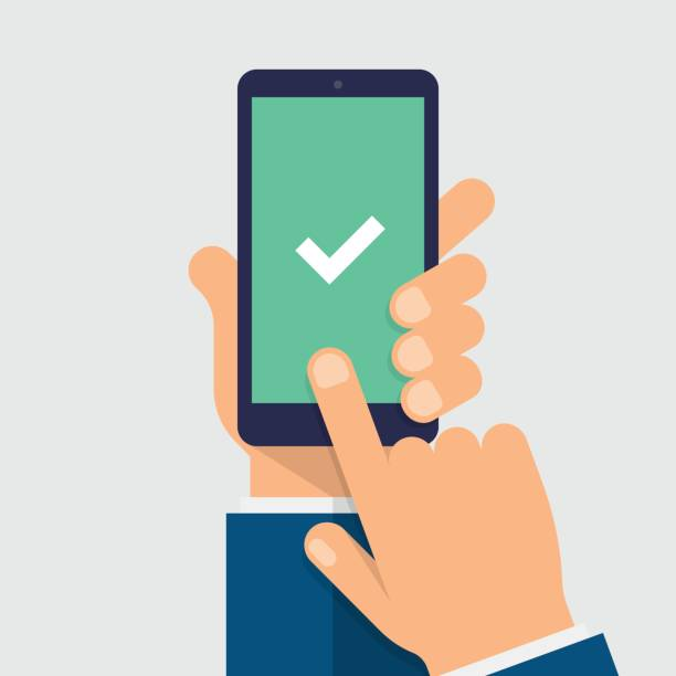 check mark on smart-phone screen. hand holding smart phone. finger on mobile device screen. modern flat vector illustration. - hand holding phone stock illustrations