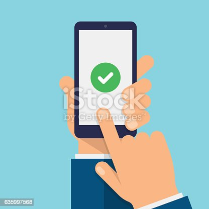 Hand holds the smartphone and finger touches screen.