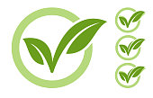 ECO checkmark icon with green leaves on white background