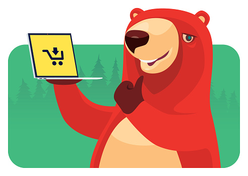 cheerful bear holding laptop and gesturing thumbs up