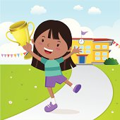 Cheerful girl holding gold trophy