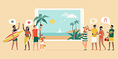Cheerful people booking a summer vacation online, they are having fun and standing next to a digital tablet with view on a tropical beach with palms