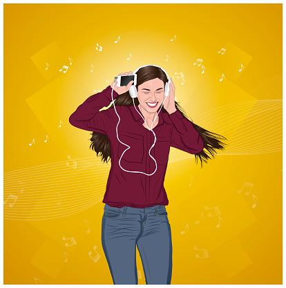 Cheerful woman listening to music on headphones