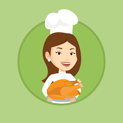 Chef cook holding roasted chicken