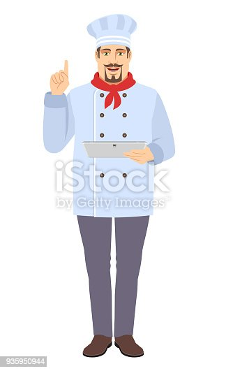 istock Chef pointing upand using digital tablet PC 935950944