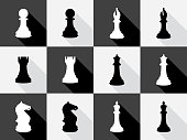 Vector illustration of a set of black and white chess icons in flat style.
