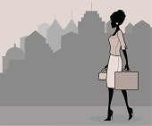 An elegant career woman on her way to work. Click below for more work and business images