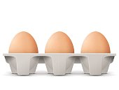 Chicken eggs in carton egg box isolated on white background