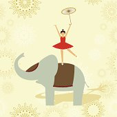 Little child performing an equilibrium show over an elephant.