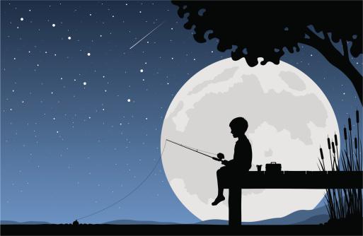 Child fishing by moonlight