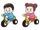 A child on a tricycle
