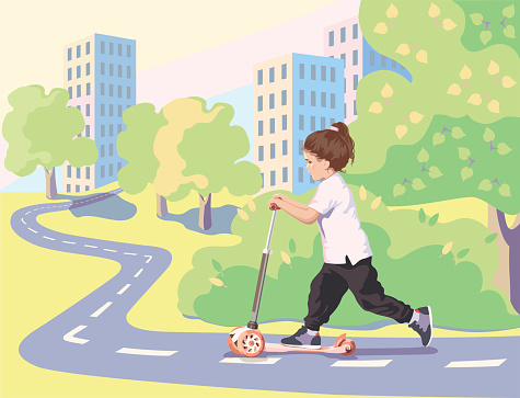 A child rides a scooter on a bicycle path