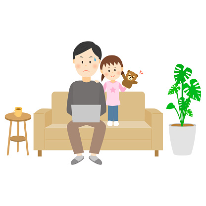 A child watching with a father who works from home on the sofa