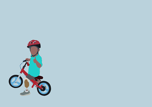 Child with a bicycle with an orthopedic leg