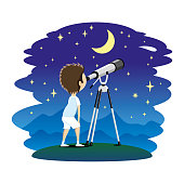 istock Child with telescope. 950770762