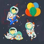 Children astronauts wearing space suits and party hats floating in outer space. Birthday party in cosmic style. Isolated vector images for your greeting cards and invitations.