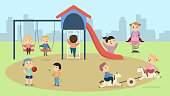 Children at playground. Happy smiling kids playing together.