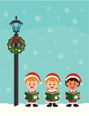A group of children caroling in Christmas time.