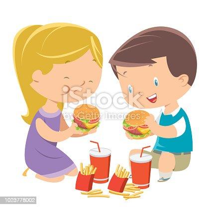 istock Children eating hamburgers 1023778002