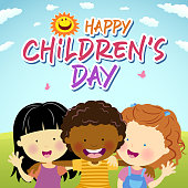 Celebrate the Children's Day with happy children embracing under the sun