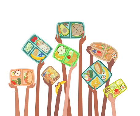 Children hands holding up lunch boxes with healthy lunches food